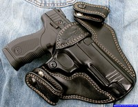 Custom holsters for concealed carry, lizard skin trim, full size pistol.