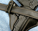 Close view of the finely stitched leather dress belt and custom IWB Gun Holster